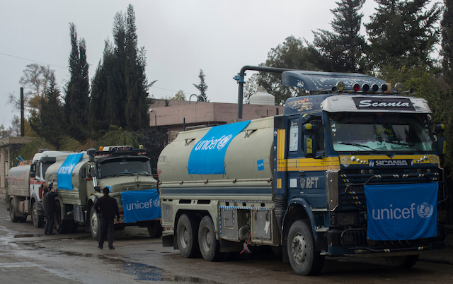 UNICEF-supported trucks queue to fill their tanks with water from a group of wells rehabilitated and equipped by UNICEF
