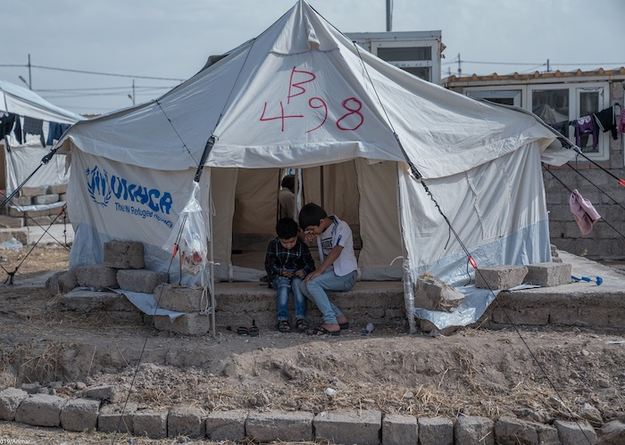 From left: Salam, 5, and Salih, 10, both from Hasakeh, Syria, are part of a wave of refugees arriving in Iraq who are receiving lifesaving assistance from UNICEF and partners. .