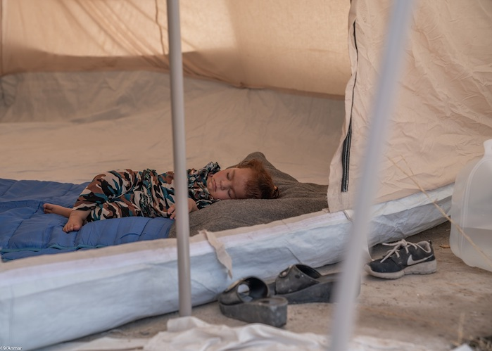 Darya, 2, from Qamishli, Syria, sleeps alone in a tent in the Barderash refugee camp in Akre, Iraq on October 21, 2019.