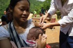 © UNICEF/LAOA2005-5276/Jim Holmes | A mother receiving a neonatal tetanus vaccination in Lao People's Democratic Republic.