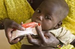 At a health center in Mali, Kadia, 10 months with severe malnutrition, eats ready-to-eat therapeutic food. © UNICEF/MLIA2012-00018/Harandane Dicko