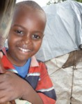 Abdi stands in a makeshift camp in Hodon District, Mogadishu, Somalia. © UNICEF Somalia/2012