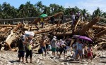 Residents are seen in the typhoon-hit town of Baganga, Davao Oriental on December 8, 2012. © UNICEF Philippines/2012/JMaitem