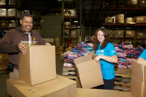 © Thelma Garcia for Julie Skarratt Photography. UPS employees joined U.S. Fund volunteers to pack 2,500 kits of warm clothing for Syrian children at a warehouse in Carteret, NJ.