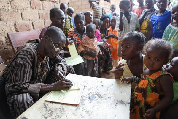 A health worker records children's information at a temporary immunization site in Bangui, CAR, during a UNICEF-supported measles vaccination campaign. © UNICEF/NYHQ2013-0288/JORDI MATAS