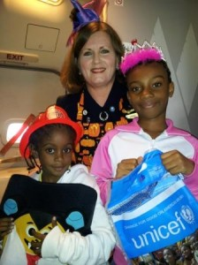 (c) U.S. Fund for UNICEF, 2013 Miami-based flight-attendant Champion for Children Andrea Hackim Trick-or-Treating for UNICEF with Romiliano Glascow and Nia-Allania Cocks