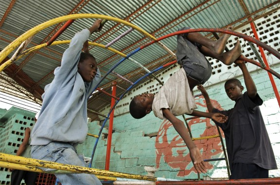 Boys play on recreational equipment at the Lakay Don Bosco centre in Port-au-Prince, after the devastating earthquake in 2010.