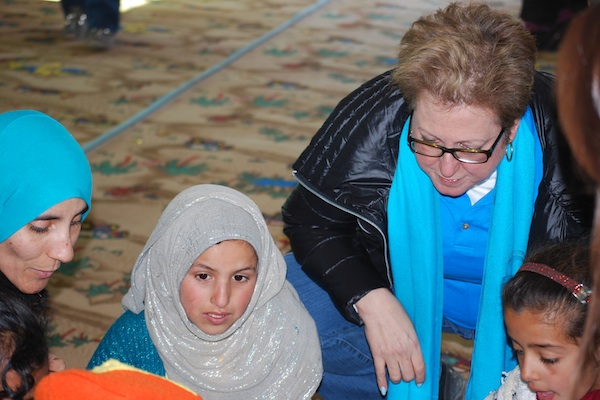 U.S. Fund for UNICEF President and CEO Caryl M. Stern meets with Syrian refugee families and children in Jordan, Dec. 2013.