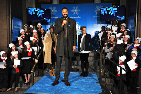 UNICEF Ambassador Tyson Chandler, his wife Kimberly Tyson and U.S. Fund President and CEO Caryl M. Stern attend the 2013 UNICEF Snowflake Lighting in New York City.