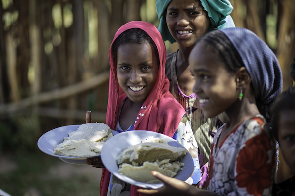 Pupils receive free school lunch at Tutis Primary School in Oromia State of Ethiopia.