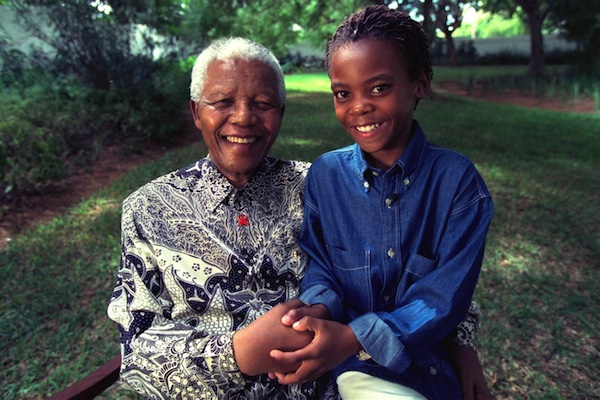 Former President of South Africa Nelson Mandela and 12-year-old Kamo join hands in support of the Global Movement for Children.
