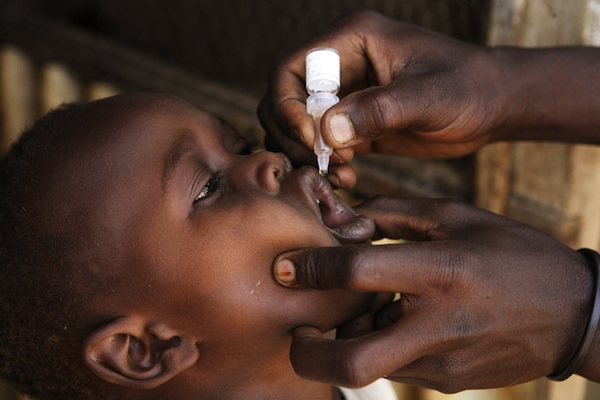 A Sudanese child is vaccinated against polio. Vaccination for more 165,000 children has been delayed due to conflict in two of the countries southern states.