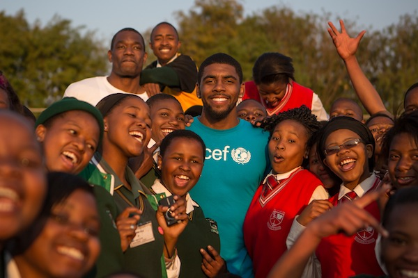 Kyrie Irving and Dikembe Mutombo visit a school in South Africa during their field visit in August.