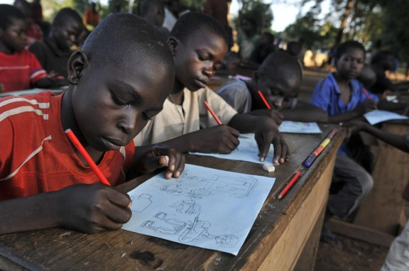 At a Child-Friendly Space in Bossangoa, Central African Republic, displaced children participate in a drawing session to manage distress from the conflict. © UNICEF/PFPG2013P-0443/ Laurent Duvillier