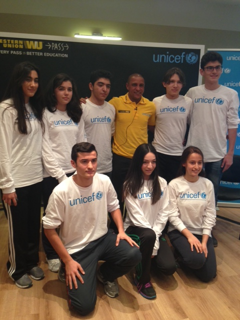 Youth from Istanbul pose with  soccer star Roberto Carlos. Photo: Katia Stefanatou.