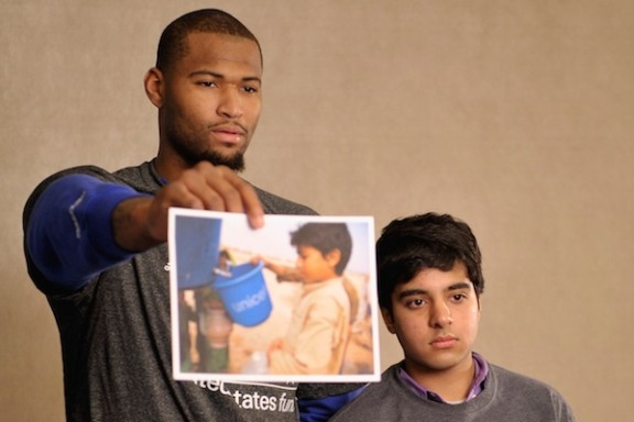 NBA athlete DeMarcus Cousins of The Sacramento Kings and a student from The United Nations International School attend an event recognizing New York City students for their efforts to help with the UNICEF Tap Project at Trump SoHo on March 8, 2014 in New York City.