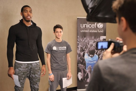 NBA athlete Jason Thompson (L) records a PSA with a student from The United Nations International School at an event recognizing New York City students for their efforts to help with the UNICEF Tap Project at Trump SoHo on March 8, 2014 in New York City. (Photo by Stephen Lovekin/Getty Images for UNICEF)