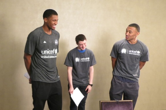 Rudy Gay and Orlando Johnson rehearse their lines with a UNIS High School student.