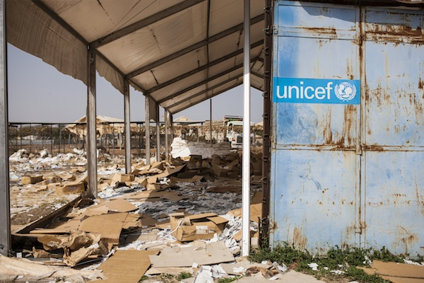 Debris is scattered outside the building that houses the UNICEF office in the city of Malakal, South Sudan. The building was ransacked during the violence that swept through the city.