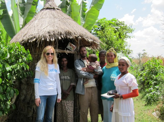 A family proudly shows their latrine to Next Gen Steering Committee Member Bettina Barrow in Ethiopia. Photo: Casey Rotter.