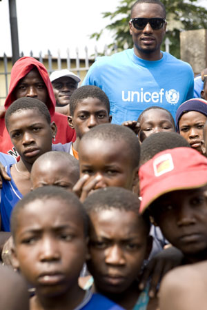 Serge Ibaka poses with children from his home country, Republic of Congo.