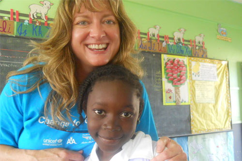 Champion for Children, Amy Cedarburg and student at St. Luke Methodist Primary School in Belize City, Belize.