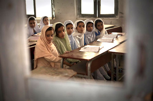 Pakistan, 2009: Girls attend a class on the first day of the restart of school at Aman Kot Girls' Primary and Middle School in Swat District in North-West Frontier Province.