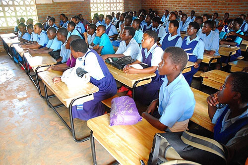 Eighth graders in Malawi sit at desks for the very first time.