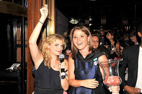 UNICEF's Next Generation Steering Committee member Megan Ferguson and chair Jenna Bush Hager call out raffle numbers. The event helped raise around $45,000.
