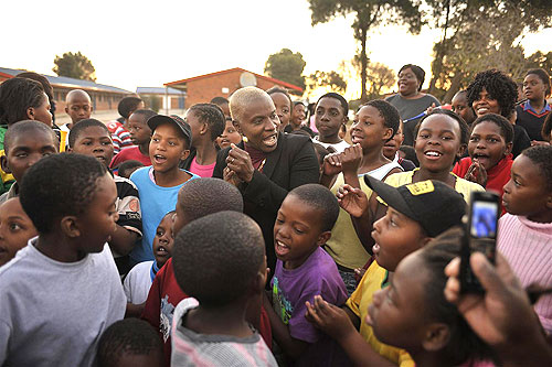 UNICEF Goodwill Ambassador Angélique Kidjo singing with children in Soweto.