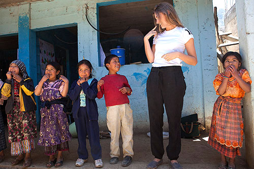 Kids sing and play games with Lauren Bush during her trip to Guatemala.