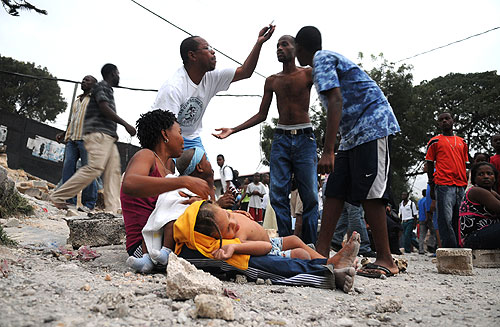 Survivors gather on a street in Port-au-Prince in the aftermath of the massive earthquake that struck Haiti on January 12, 2010.